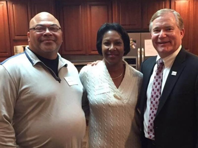 Troy DeLawrence '93 (left) and Mavis McKenley '11 (center) with President Scott D. Miller