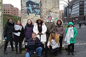 Virginia Wesleyan history students with sections of the Berlin Wall, Berlin, Germany, January 19, 2018. Anonymous photographer.