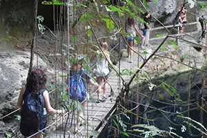Virginia Wesleyan students exploring Ek Balam's cenote in Yucatan, Mexico. Photograph by Diana Risk.