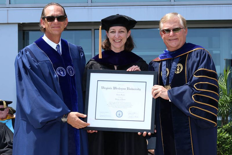 VWU President Scott D. Miller (right) presented Rep. Elaine Luria (center) and VWU Board Chair David Kaufman (left) honorary doctoral degrees during the ceremony.